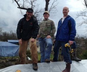 Ty Sullivan (left) and several volunteers covered roofs around Hattiesburg, Miss., after a tornado.