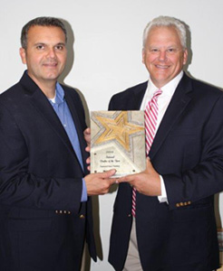Al Olivia, left,  of Film Star Distribution and Eddy Russell, right, owner of Sunset Glass Tinting and three-time winner of 3M's Dealer of the Year award, were recently honored by 3M.