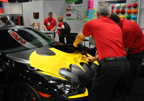 This 3M wrap featuring a Batman symbol was a huge draw. A Browning wrap was even featured in an automotive accessories booth that was selling floor mats and steering wheel covers. Wraps were everywhere!
