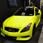 "An Infiniti wrapped in a matte style at Arlon's booth. The color, named ""highlighter yellow,"" was custom-ordered by Frank Fellers, president of FELLERS, a wrap supply company."