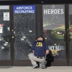 An FBI investigator investigates the scene of a shooting outside a military recruiting center on Friday, July 17, 2015, in Chattanooga, Tenn. Muhammad Youssef Abdulazeez of Hixson, Tenn., attacked two military facilities on Thursday, in a shooting rampage that killed four Marines. (AP Photo/John Bazemore)