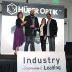David Kratz and his wife accept Hüper Optik's Synnergy Award for a large market.