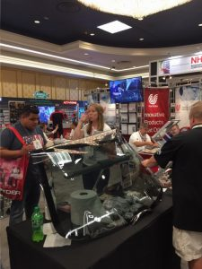 Attendees trying out HanitaTek's new window film.